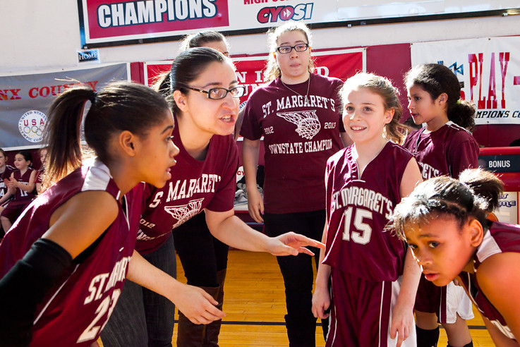 Head coach Gina Nieves huddles with her St. Margaret�s basketball team during the game that set them up to win the Catholic Youth Organization�s Archdiocesan State Championship.