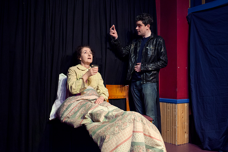 Katherine O'Sullivan and Paul Nugent play May and Victor in the short play, 'Boys Swam Before Me,' written by Seamus Scanlan and directed by Don Creedon. The play was part of The Poor Mouth Theatre Company's 'Puttin' on YourShorts 5,' performed at An Beal Bocht Café on Saturday.
