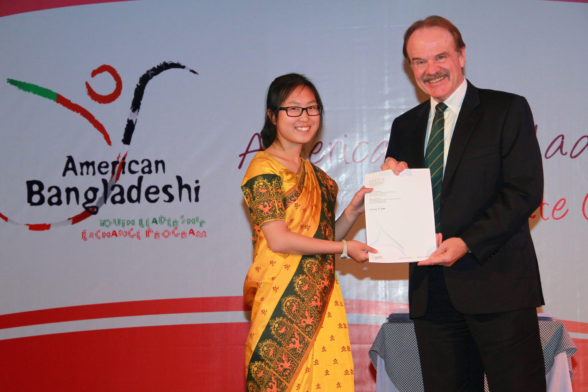 Julia Lee (left) at the closing ceremony of her month in Bangladesh