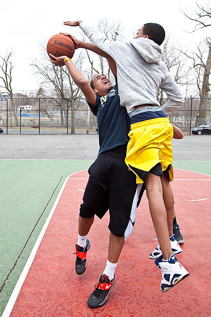 Henry Agront, 13, at left, tries to make a basket as Albert Reyes, 14, blocks his view during a friendly game of street ball at Spuyten Duyvil Playground on March 28.