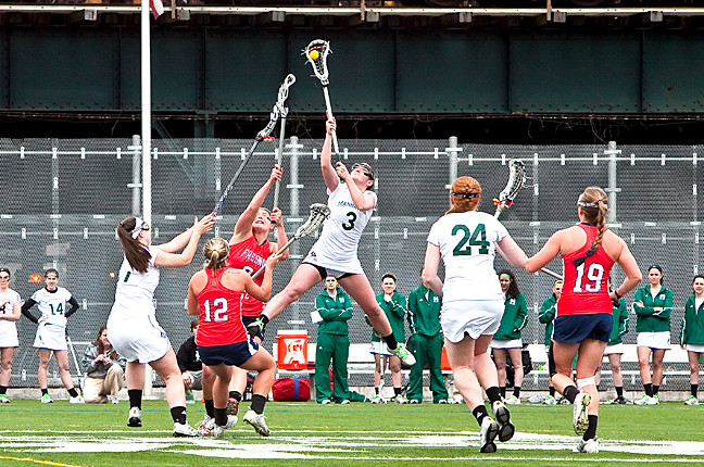 Clare Kerrisk, playing for Manhattan College Jaspers Women�s Lacrosse team, leaps into the air to gain control of the ball during a match against the Fresno State Bulldogs at Gaelic Park on March 29. Jaspers lost 11-10.