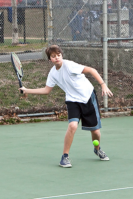 Ezra Mutnick, 16, swings his tennis racket at the Seton Park courts on March 28.
