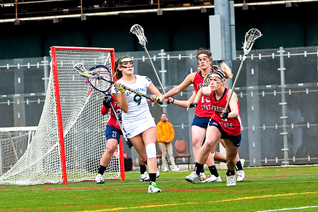 Megan Yarusso, No. 9 on Manhattan College Jaspers Women�s Lacrosse team, passes the ball to a teammate during the game against Fresno State on March 29.