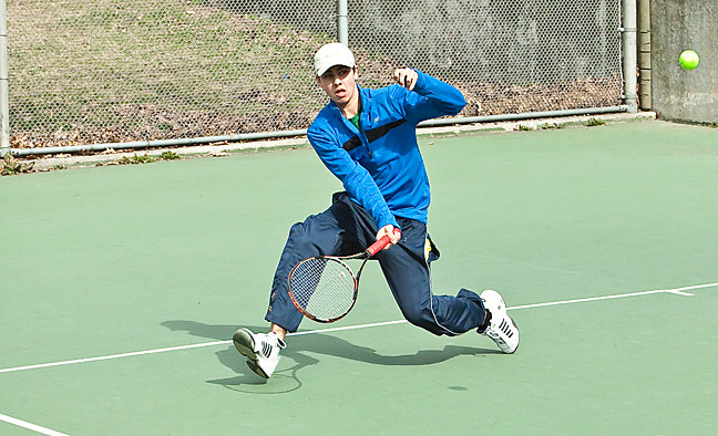 Remi Kumar, 15, returns a volley at the Seton Park courts on March 28.