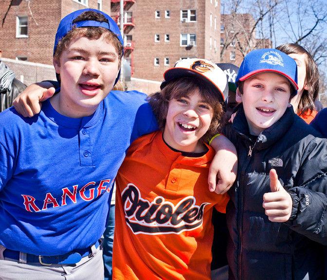 Healy Tureski, Tim Markbreiter and Joshua Golidin McCarthy, from left to right, pose for a photo at the Little League parade on Saturday.