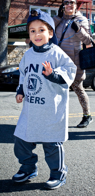 John Paul Brox, 4, from the North Riverdale Baseball League Tigers, waves to the camera.