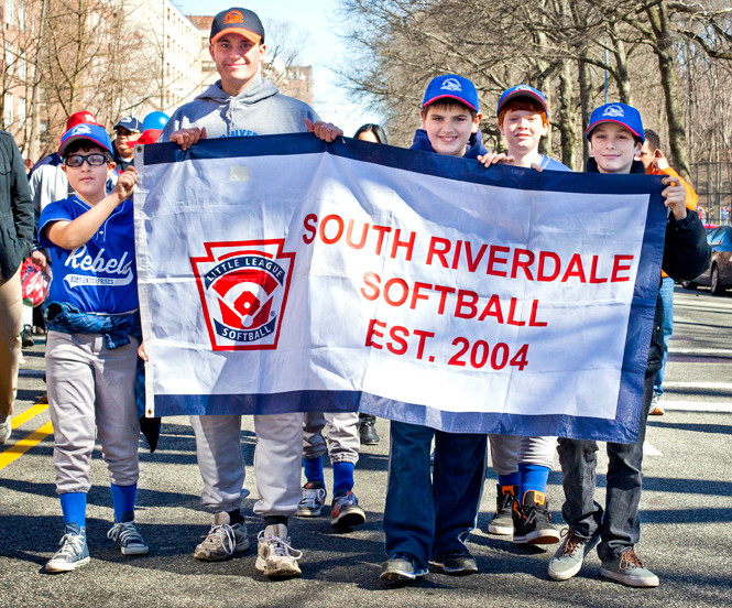 Billy Schuster, coach Alex Patsalos, Josh Kenny, Seamus Henry and Joshua Golidin McCarthy carry a South Riverdale Softball banner during Saturday�s parade.