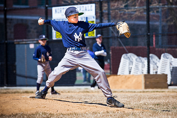 London Cuevas pitches for the Yankees during the first Little League game played at the newly renovated Sid Augarten Field on Saturday.