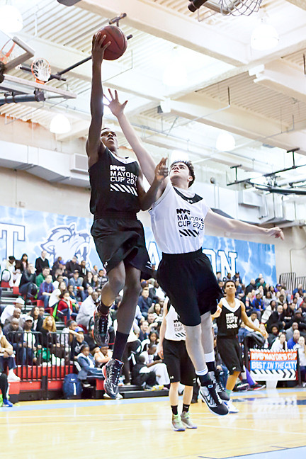 Kennedy Campus basketball star Muhammed Ahmed makes a basket at the Mayor's Cup All Star game, held at Baruch College on April 5. Ahmed scored 20 points for the PSAL.