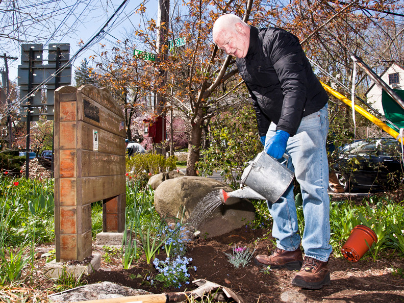 Bob Bowen, 57, above, waters newly planted flowers at Endor Community Garden on Sunday.
