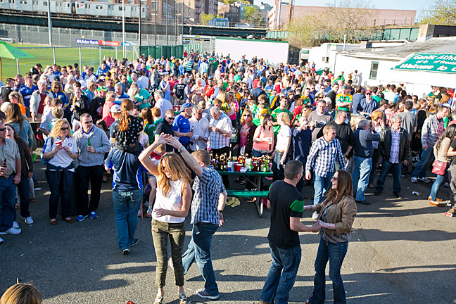 Irish football fans dance at Gaelic Park.