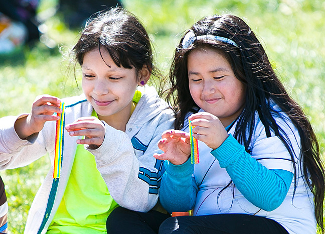 Paloma Sanchez, 9, and Leslie Rubi Bastidas, 5, eat sour rainbow candies in Vannie.