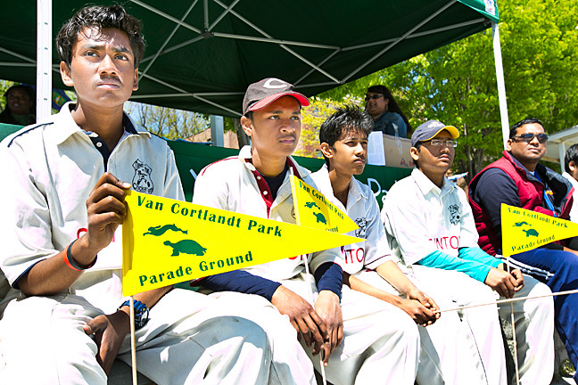 Rakib Kazi, Khairul Islam, Fm Hasib, and Md Muyin, all students at Dewitt Clinton High School, watch opening ceremonies at the Parade Ground cricket fields.