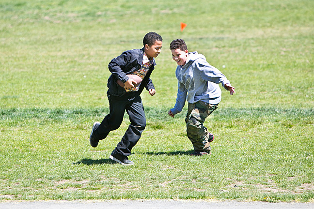 Angel Azcona, 11, and Giovanni Veilleux, 9, below, play football in Vannie.