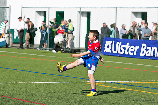 Ronan McAllister, 9, kicks the football in between games at Gaelic Park on Sunday. Credit: Marisol Díaz