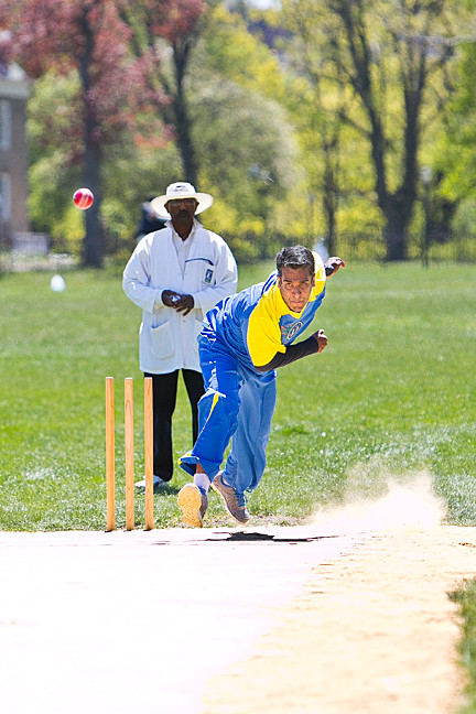 Pradeep Mysore, bowler for the Long Island Titans plays cricket at the Parade Ground Opener at Van Cortlandt Park on Sunday.