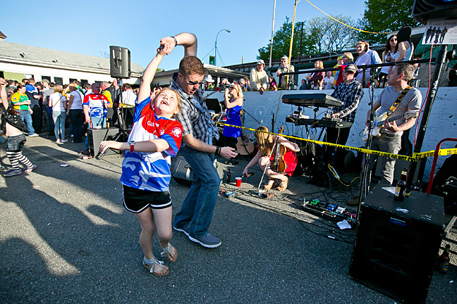 Claire Reilly, 7, and her dance partner Mel McCormack dance to the music by of McLean Avenue at Gaelic Park on Sunday.