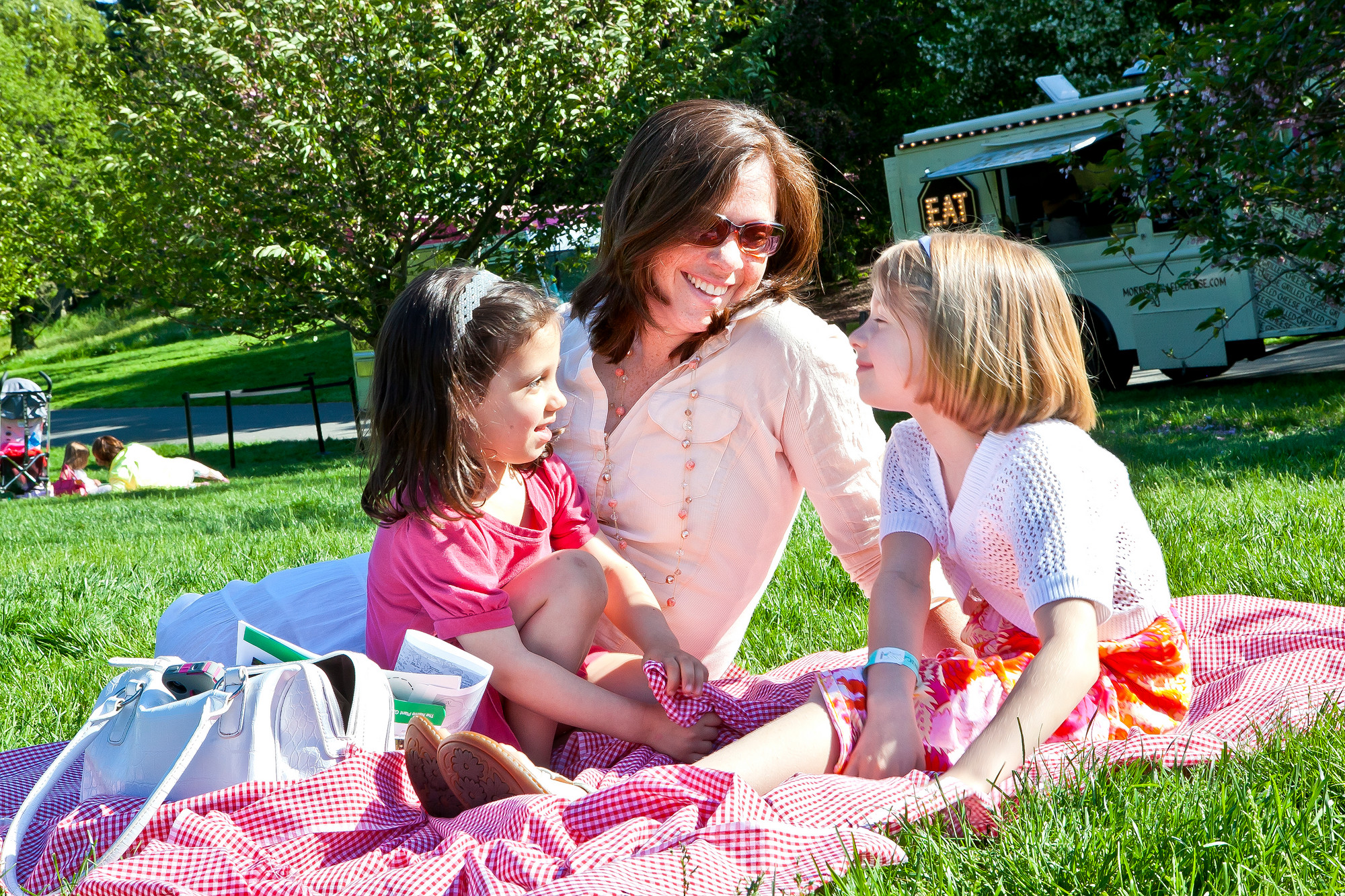 Kathleen Acuti celebrates Mother's Day with her two daughters Megan Acuti, 4, at left,  and Clare Acuti, 7, at right, at New York Botanical Garden on Sunday.