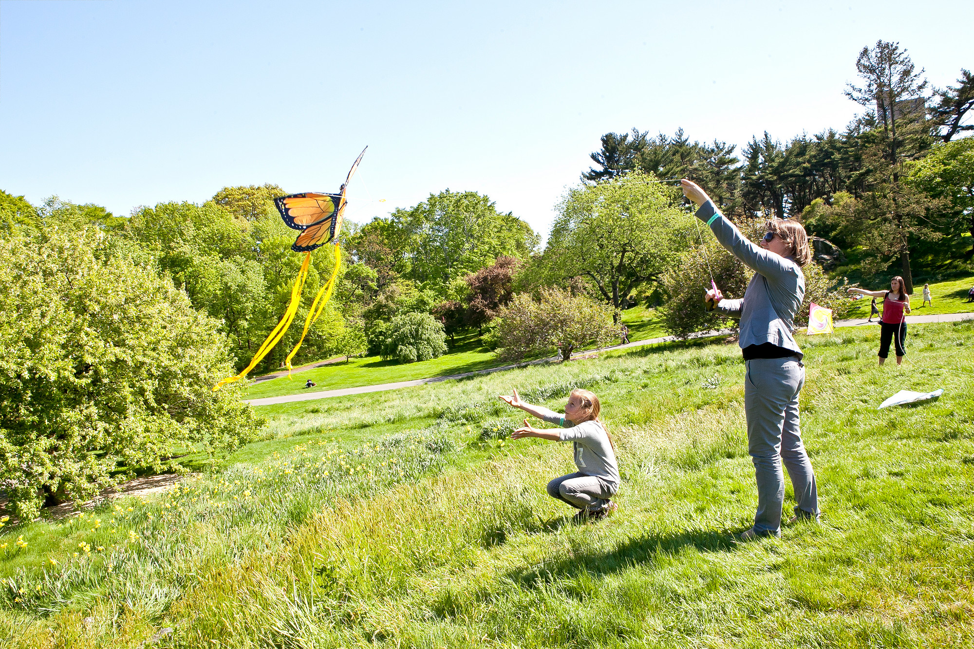 VERONIKA IAGNIUK, 8, and her mom Nataliia Lagniuk learn to fly a kite together during the Mother's Day Garden Party on Daffodil Hill at New York Botanical Garden on Sunday.