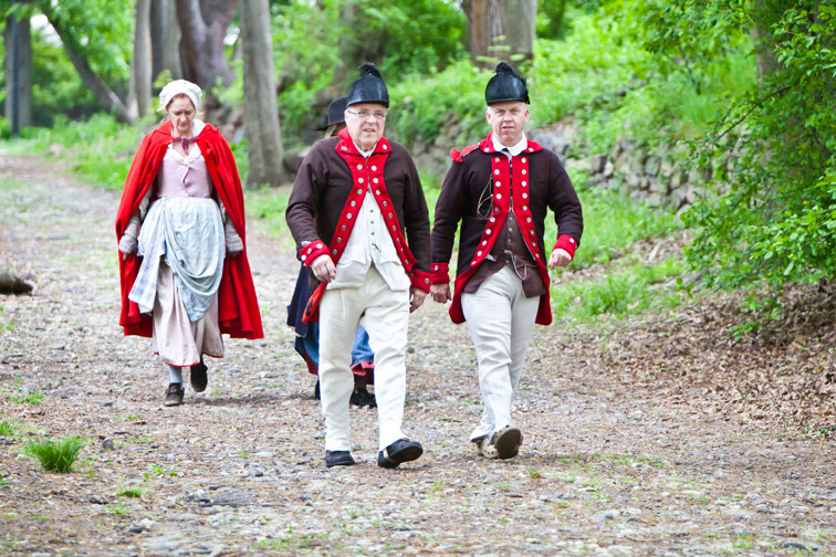 Gabrielle Long, Tom Kinter and Karl Fritzinger make their way through Van Cortlandt Park after their Revolutionary War reenactment at the Van Cortlandt Museum on Saturday.