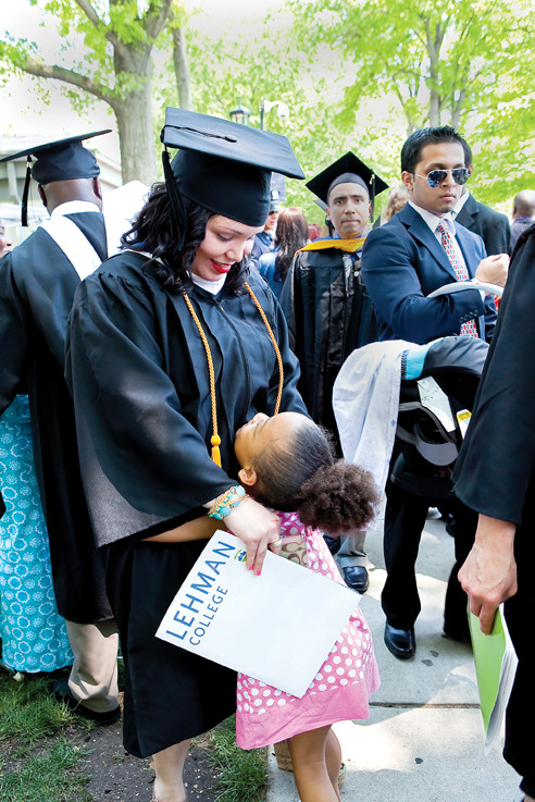 Kira Scott, 6, hugs her mom, Lehman graduate Luisa Scott.