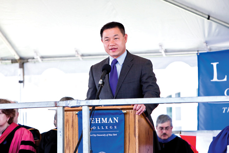 City Comptroller John Liu congratulates Lehman College class of 2013 on May 30.