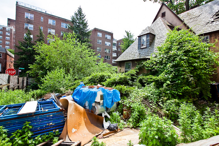 Neighbors have been complaining about what appears to be an abandoned home on West 238th Street and Blackstone Avenue. It is surrounded by plywood behind which an overgrown lawn and construction materials have been left untended.