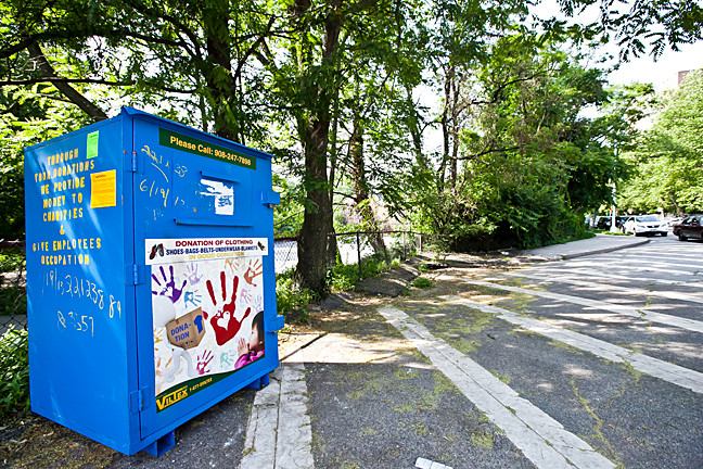 A clothing donation box sits on Independence Avenue near Riverdale Temple on June 21 after the city condemned it for removal.