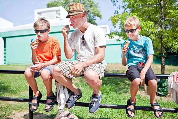 Dante Ragel, 11, his dad John and brother Hugo, 10, cool off with ice cream and ices as they wait for the pool at Van Cortlandt Park to re-open on Saturday.