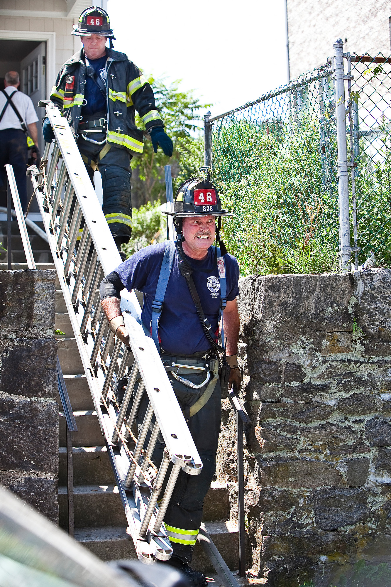 FIRE OFFICIALS respond on July 17 to a fire smoldering at 436 W. 259th St., which is being remodeled. More than 20 firefighters put out the flames in under an hour. FDNY officials are still investigating what sparked the fire.