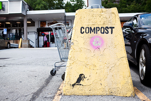 The Early Bird urges his neighbors to compost. At least, that's the apparent message of graffiti stenciled on a lightpost outside the Skyview Shopping Center in North Riverdale.