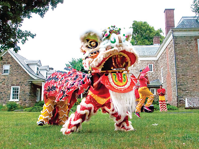Ferocious performers from the Keito Academy conduct a Chinese Lion Dance on the lawn of the Van Cortlandt House museum on July 25.