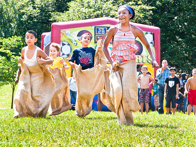 Children potato sack race each other at Kids Rule Weekend at Lehman College on Saturday.