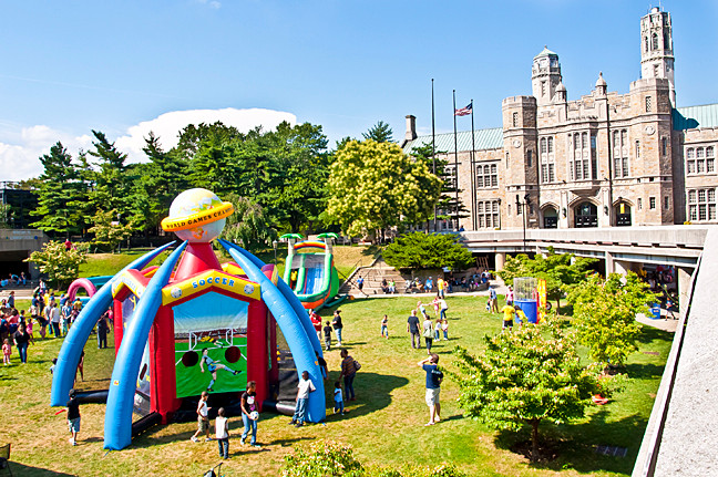 Inflatable carnival rides fill the Lehman College quad.