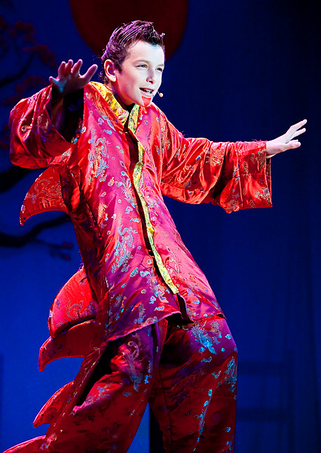 Josh Goldin-McCarthy,12, plays Mushu, the dragon who protects and guides the title character in Disney's 'Mulan, Jr.' presented by the Riverdale Rising Stars' Summer Stage.