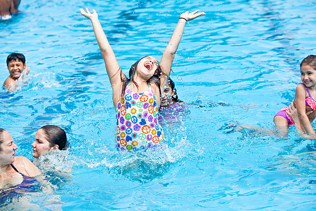 June 29 - J'Lanee Acevedo, 11,  celebrates her first day in the Van Cortlandt Park Pool.