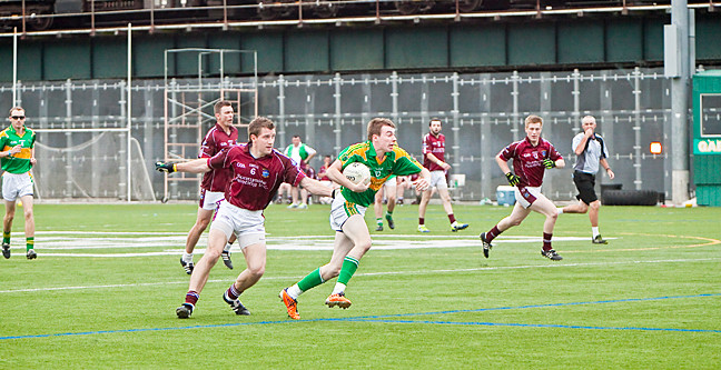 Keith Scally, center back for Westmeath, chases Adrian Wynne, half forward for St. Barnabas in a Gaelic Football Championship game on Aug. 11.