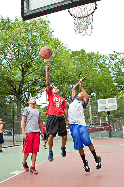 Raymond Rivera, 14, John Jaquez, 14, and Emmanuel Bisono, 14, shoot some hoops at Bailey Playground on Aug. 11.