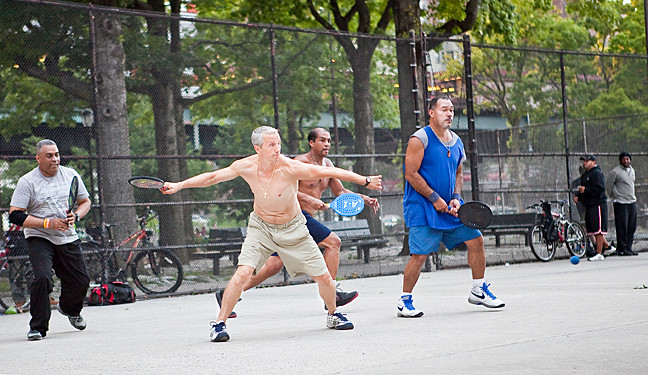 Alfred Merini returns the serve in a game of racquetball with Cesar Benitez, Tony Martin and Carlos Rivera at the handball courts at Van Cortlandt Park on Aug. 11