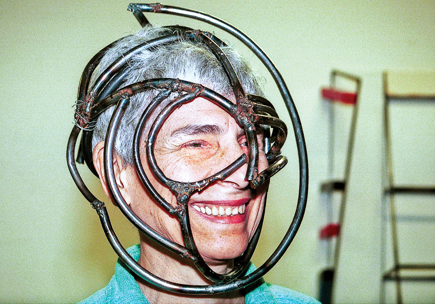 Helene Brandt models a mask she had been working on in her East Village studio in 1999.