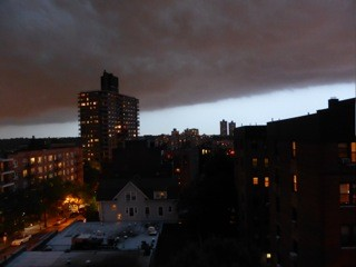 Just before the storm, clouds amass over the Bronx