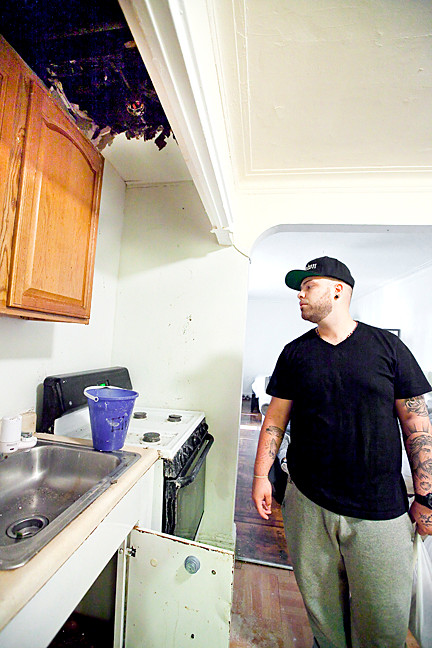 Thomas Lake views his collapsed kitchen ceiling prior to a Sept. 20, 2013 fix that he called shoddy.