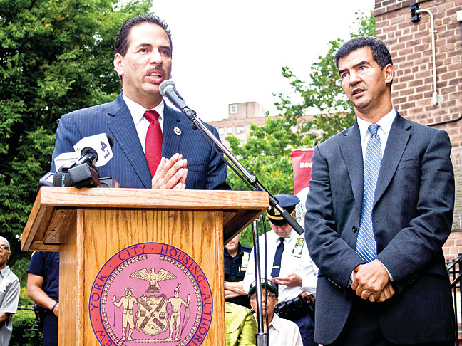 Councilmen Fernando Cabrera and Ydanis Rodriguez discuss the installation of security cameras at the Marble Hill Houses during a press conference on Oct. 3.