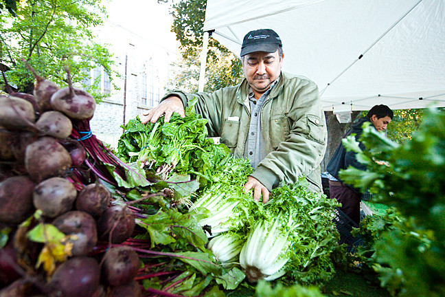 Mr. González sets up beets and leafy greens at the farmer's market, located on a yard at the Church of the Mediator at 260 West 231st Street, on Oct. 20.