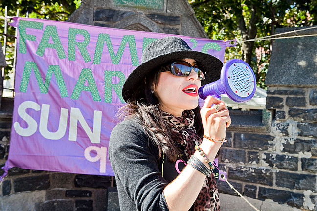 Farmer's market co-organizer Lucy Mercado spreads the word on Oct. 20.