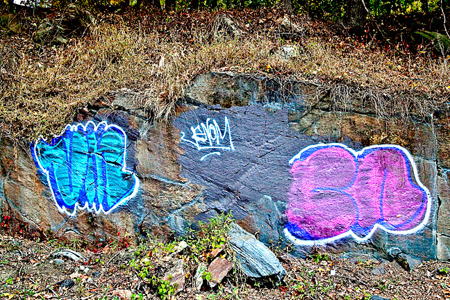 Graffiti covers large rocks just outside of exit 22 on the Henry Hudson Parkway.