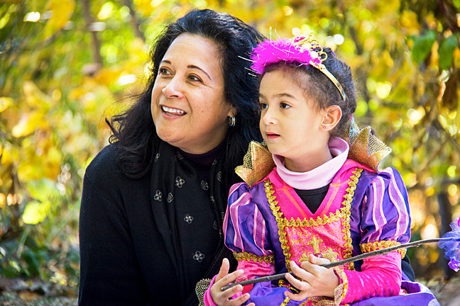Daisy Otero-Rivera and her daughter Faith Rivera, 4, listen to a storyteller at Wave Hill during the Enchanted Wave Hill Weekend on Sunday.