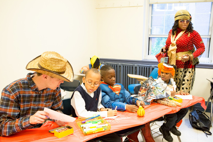 Manhattan College Students helped children to create and paint Halloween necklaces at a college party on Friday.
