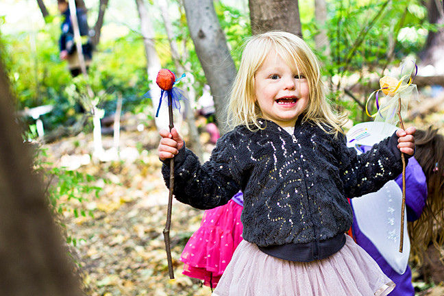 Aria Smilevsky, 2, holds up her fairy wands at Wave Hill during the Enchanted Wave Hill Weekend on Sunday.