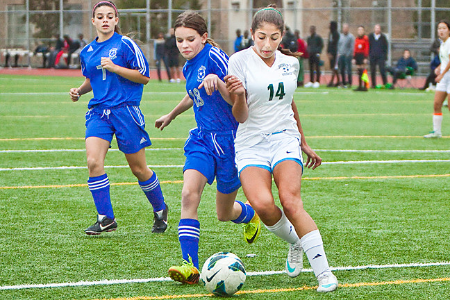 Bronx High School of Science's Amanda Kahn, No. 14, keeps a Fort Hamilton opponent at bay on Oct. 30.